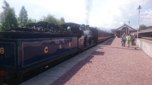 Strathspey Double - Steam train and carriages