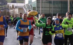 Balloon obscures runners race photo